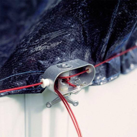 Pestillo de seguridad tensor de la cubierta